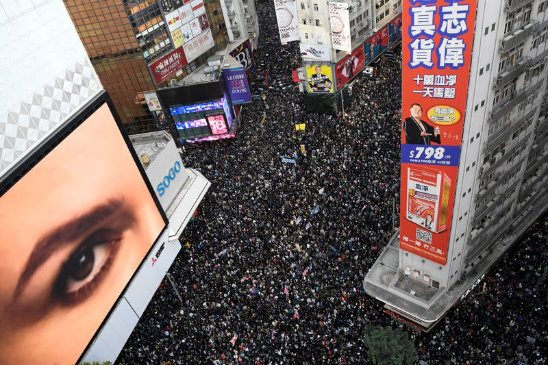 FILE PHOTO: File photo of people attending a Human Rights Day march in Hong Kong