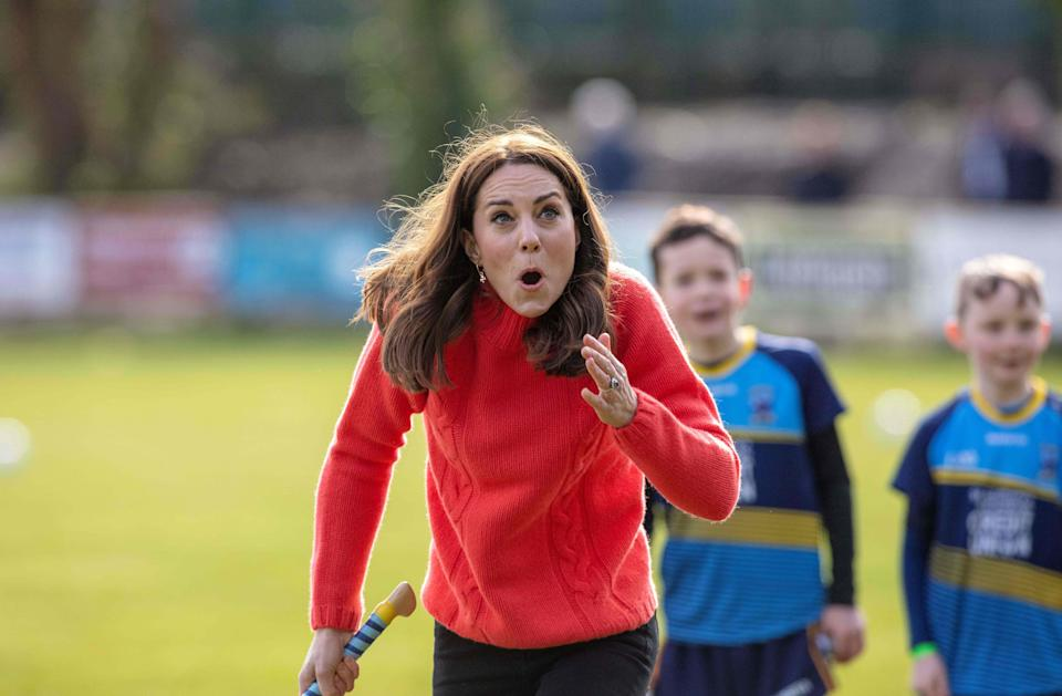 Kate reacted hilariously when she had a go at hurling at the Salthill Gaelic Athletic Association (GAA) club in Galway, in March 2020. (Paul Faith/AFP)