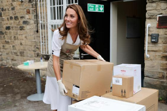The duchess assisted workers with unloading deliveries (Getty)