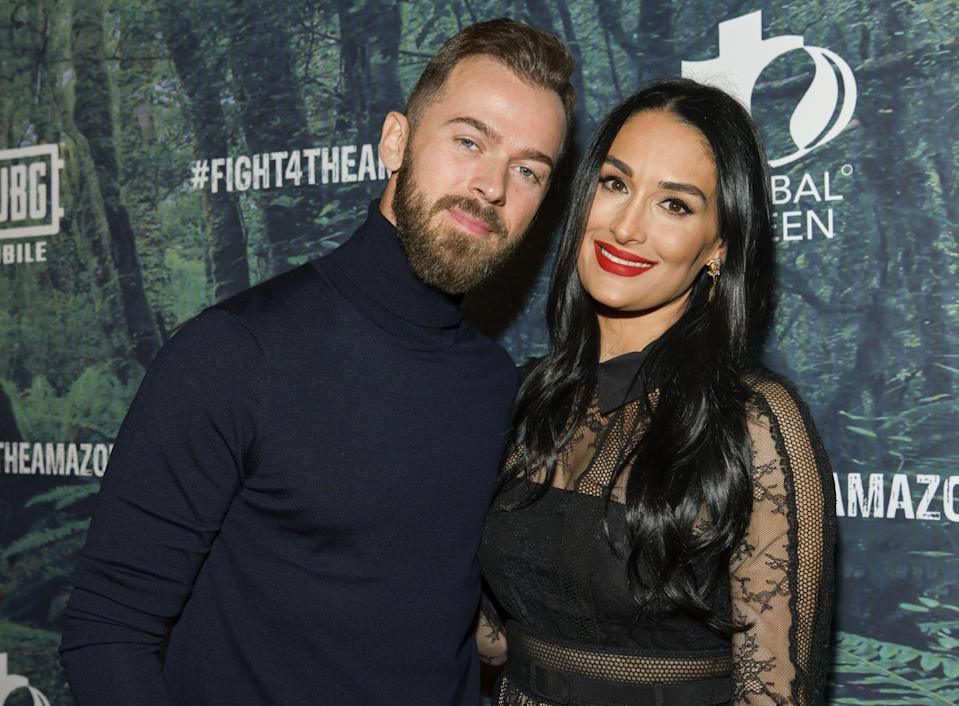 "<p>Nikki and Artem rang in 2020 by <a href=""https://people.com/tv/nikki-bella-artem-chigvintsev-engaged/"" class=""link rapid-noclick-resp"" rel=""nofollow noopener"" target=""_blank"" data-ylk=""slk:announcing their engagement on Instagram"">announcing their engagement on Instagram</a>. ""I said yes in France in November!"" the <strong>Total Bellas</strong> star captioned a <a href=""https://www.instagram.com/p/B63uTAMlkfG/?utm_source=ig_web_copy_link"" class=""link rapid-noclick-resp"" rel=""nofollow noopener"" target=""_blank"" data-ylk=""slk:photo of her and Artem kissing"">photo of her and Artem kissing</a>. ""We have been trying to keep it a secret but really wanted to share our excitement for the New Year!"" The good news comes after <a href=""https://www.instagram.com/p/B63uTJEgVyp/?utm_source=ig_web_copy_link"" class=""link rapid-noclick-resp"" rel=""nofollow noopener"" target=""_blank"" data-ylk=""slk:she and the Dancing With the Stars alum"">she and the <strong>Dancing With the Stars</strong> alum</a> reconnected following <a href=""https://www.popsugar.com/celebrity/Did-Nikki-Bella-John-Cena-Break-Up-45119279"" class=""link rapid-noclick-resp"" rel=""nofollow noopener"" target=""_blank"" data-ylk=""slk:Nikki's 2018 split from John Cena"">Nikki's 2018 split from John Cena</a>.</p>"