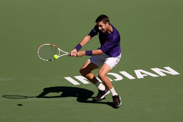 Britain's Cameron Norrie on the way to a quarter-final victory over Argentina's Diego Schwartzman in Indian Wells (AFP/Sean M. Haffey)