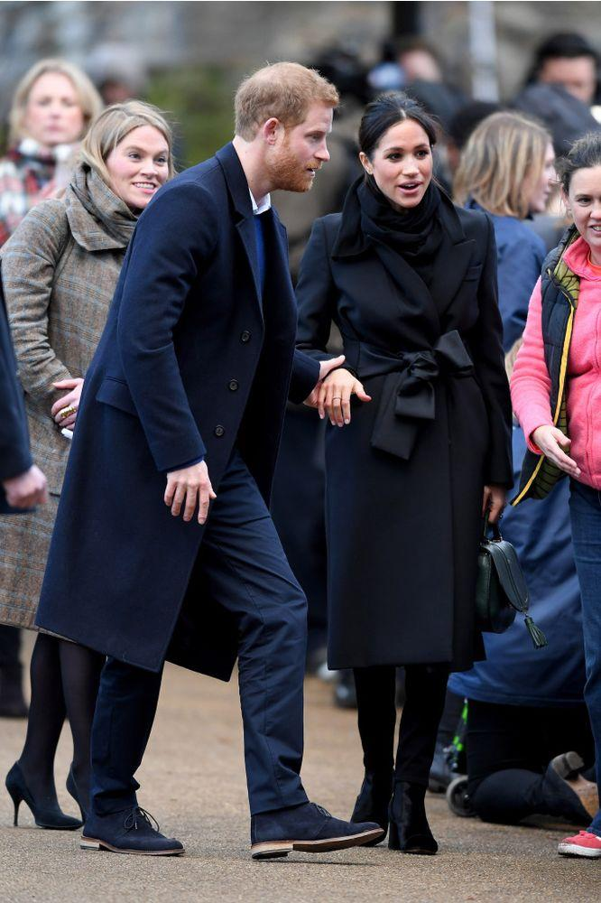 Amy Pickerill with Prince Harry and Meghan Markle in Cardiff, Wales on Jan. 18, 2018.