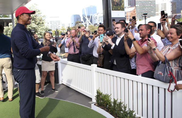 U.S. captain Tiger Woods poses for photos for fans during a media conference in Melbourne, Thursday, Dec. 6, 2018. Woods will have discussions with golf officials in Melbourne on how to best prepare his team for the 2019 Presidents Cup next December at Royal Melbourne. (David Crosling/AAP Image via AP)
