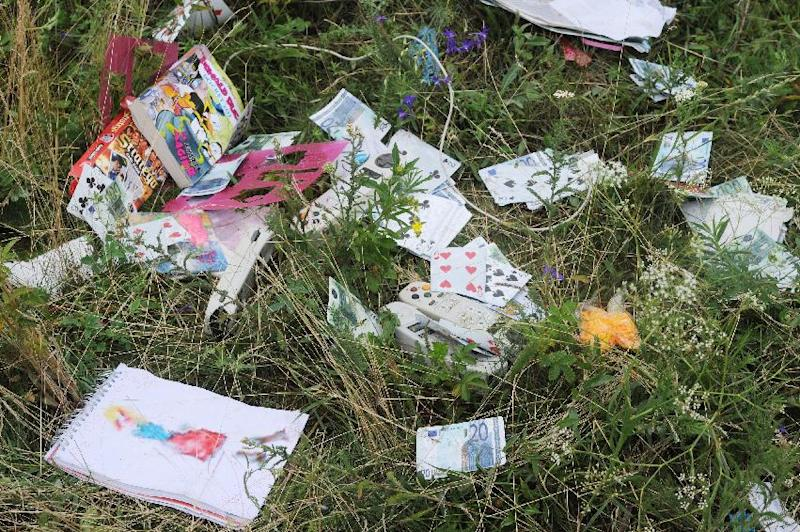 Belongings of passengers on the site of the crash of the Malaysia Airlines jet, near Shaktarsk, in east Ukraine