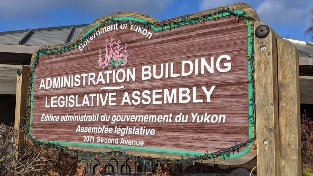 The exterior sign at the Yukon Legislative Assembly in Whitehorse. The government delivered its proposed 2021-22 budget on Thursday. (Chris Windeyer/CBC - image credit)