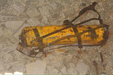 Handout photo provided to Reuters on February 13, 2017, by Human Rights Watch claiming to show remnant of yellow gas cylinder found in Masaken Hanano, Aleppo, Syria after a chlorine attack on November 18, 2016. Courtesy of Human Rights Watch/Handout via REUTERS