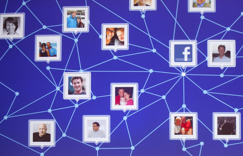 A graphic display of a Facebook network is shown at a Facebook event for marketing professionals, Wednesday, Feb. 29, 2012 in New York. New, potentially lucrative advertising opportunities are coming to Facebook as a prelude to its initial public offering of stock. The idea is to lure big brands with the promise of effective, precisely targeted ads that reach the social network's 845 million users. (AP Photo/Mark Lennihan)