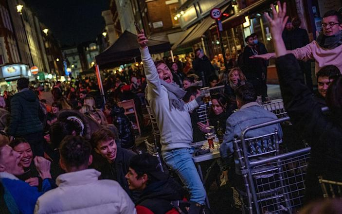 Revellers drink in Soho as non essential retail reopens - Chris J Ratcliffe