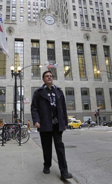 Sean Toohey, a grains broker at the Chicago Board of Trade, who had hip replacement surgery last summer, walks home from work Monday, Feb. 11, 2013, in Chicago. Routine hip replacement surgery on a healthy patient may cost as little as $11,000 _ or up to nearly $126,000. Toohey said he has good health insurance that covered most of the costs, and it didn't occur to him to ask about price beforehand. (AP Photo/M. Spencer Green)