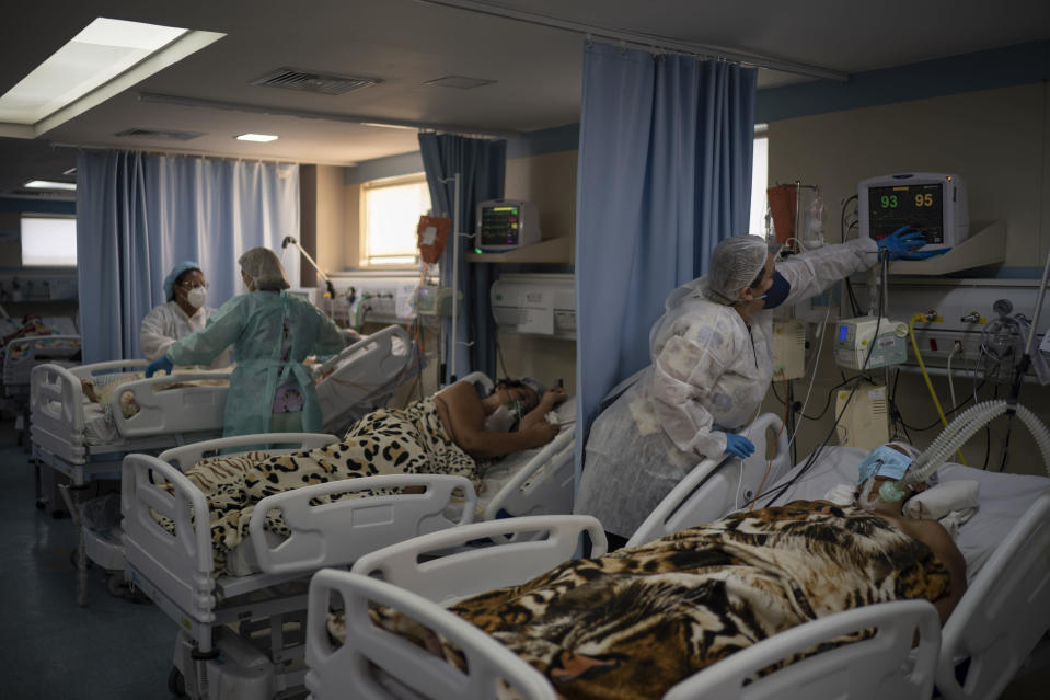 COVID-19 patients are treated in the ICU of the Sao Jose municipal hospital, in Duque de Caxias, Brazil, Wednesday, March 24, 2021. (AP Photo/Felipe Dana)