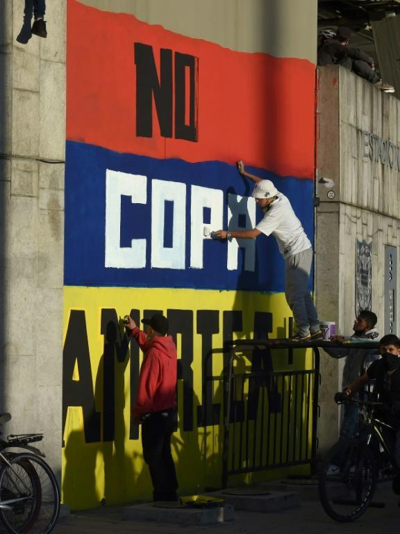 """Street artists painted a grafitti reading """"No Copa America"""" at a Bogota stadium during anti-government protests"""