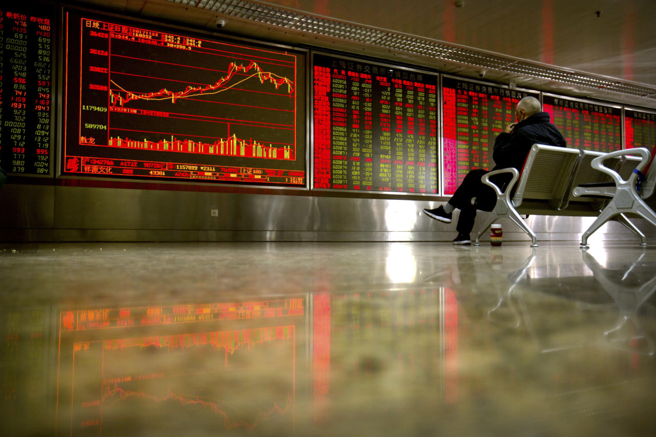 A Chinese investor monitors stock prices at a brokerage house in Beijing, Wednesday, Nov. 22, 2017. Asian stocks rose Wednesday after Wall Street hit new highs ahead of the two-day U.S. break for the Thanksgiving holiday. (AP Photo/Mark Schiefelbein)