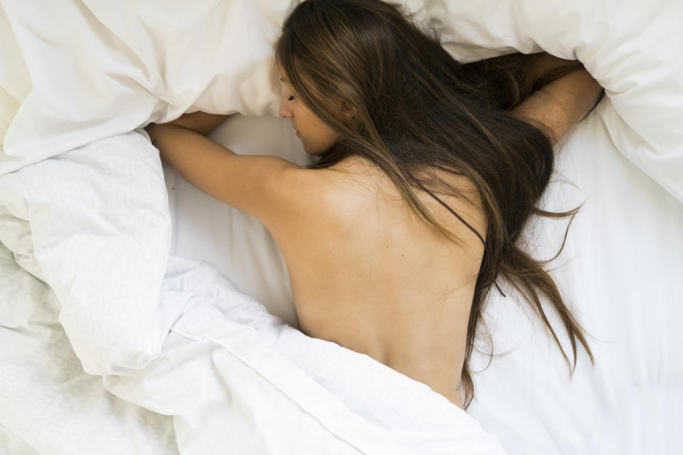 Experts warn that sleeping in the nude will make you hotter than sleeping in pyjamas. (Photo: Getty)