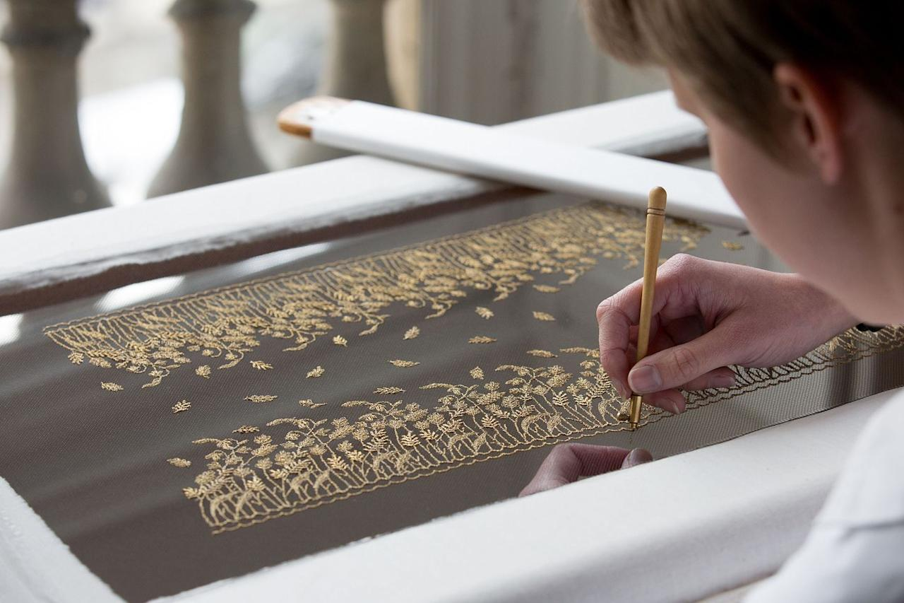 <p>The embroidery was made by the renowned Vermont atelier in Paris, who designed ears of wheat and wild flowers in antique gold thread. </p>