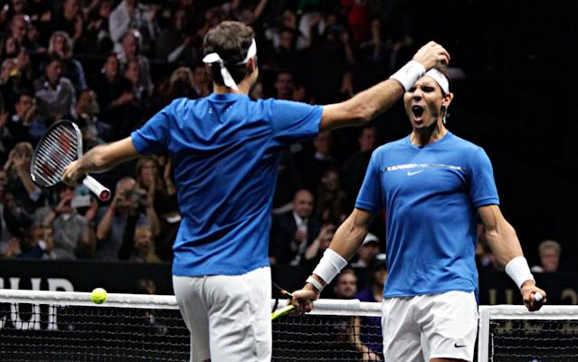 Roger Federer and Rafa Nadal celebrate their doubles victory - EPA