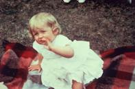 <p>Diana hangs out on a picnic blanket on her first birthday at Park House, Sandringham. </p>