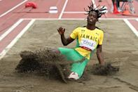 <p>Jamaica's Tajay Gayle competes in the men's long jump final during the Tokyo 2020 Olympic Games at the Olympic Stadium in Tokyo on August 2, 2021. (Photo by Andrej ISAKOVIC / AFP)</p>
