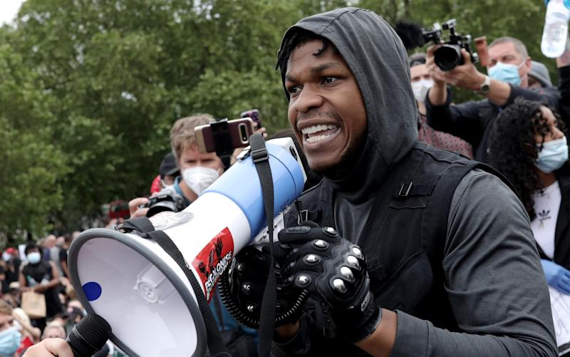 John Boyega speaks to the crowd during a Black Lives Matter protest in Hyde Park in June - Dan Kitwood/Getty Images Europe