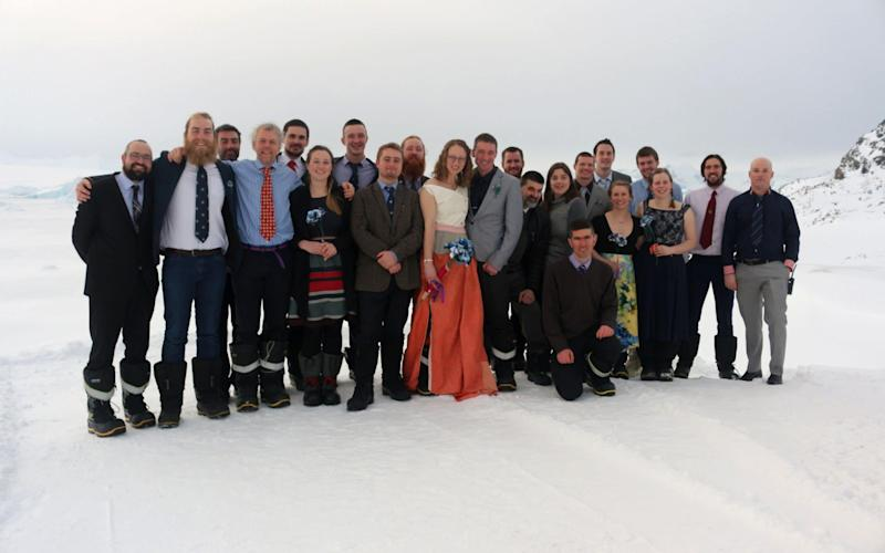 Polar field guides Julie Baum and Tom Sylvester with their fellow researchers on the day of the wedding - Credit:  British Antarctic Survey/PA