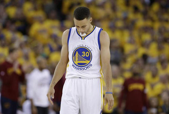 "<a class=""link rapid-noclick-resp"" href=""/nba/players/4612/"" data-ylk=""slk:Stephen Curry"">Stephen Curry</a> walks on the floor during the second half of Game 5 of the 2016 NBA Finals. (AP/Marcio Jose Sanchez)"