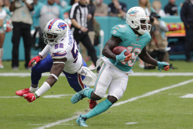 Buffalo Bills linebacker Corey Thompson (52) misses a tackle as Miami Dolphins wide receiver Jakeem Grant (19) runs for t touchdown, during the first half at an NFL football game, Sunday, Nov. 17, 2019, in Miami Gardens, Fla. (AP Photo/Lynne Sladky)