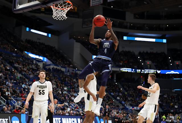 <p>Ahmad Caver #4 of the Old Dominion Monarchs drives to the basket against Sasha Stefanovic #55 of the Purdue Boilermakers in the first half during the first round of the 2019 NCAA Men's Basketball Tournament at XL Center on March 21, 2019 in Hartford, Connecticut. </p>