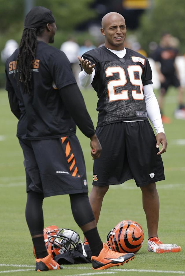 Cincinnati Bengals cornerback Leon Hall (29) talks with free safety Reggie Nelson during the NFL football team's first practice at training camp, Thursday, July 24, 2014, in Cincinnati. (AP Photo)