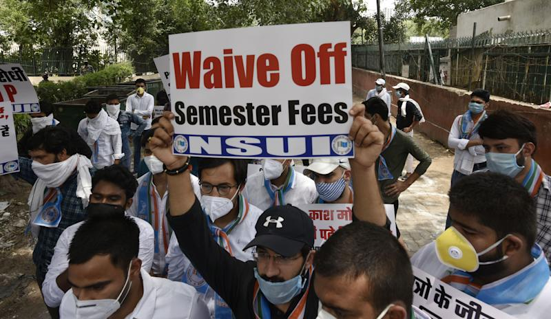 Members of the NSUI protest demanding fee waivers, the cancellation of all university exams and promotion of all students due to the Covid-19 pandemic, at the HRD Ministry Office at Shashti Bhawan on July 1, 2020 in New Delhi, India. (Photo by Vipin Kumar/Hindustan Times via Getty Images)
