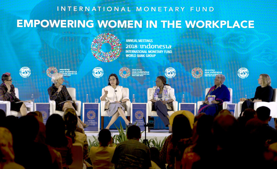 From left to right, Indonesian television journalist Rosianna Silalahi, Managing Director of International Monetary Fund (IMF) Christine Lagarde, Indonesia's Finance Minister Sri Mulyani, Executive Secretary of the United Nations Economic Commission for Africa Vera Songwe, Executive Director of the International Women's Rights Action Watch, Asia Pacific, Priyanthi Fernando, and Senior Deputy Governor, Bank of Canada Carolyn Wilkins talk during Empowering Women in the Workplace seminar panelists at International Monetary Fund-World Bank meeting in Bali, Indonesia Tuesday, Oct. 9, 2018. (AP Photo/Firdia Lisnawati)