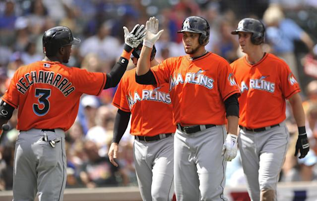 Miami Marlins' Henderson Alvarez, right foreground, celebrates with teammate Adeiny Hechavarria (3), after hitting a three-run home run during the second inning of a baseball game against the Chicago Cubs in Chicago, Monday, Sept. 2, 2013. (AP Photo/Paul Beaty)