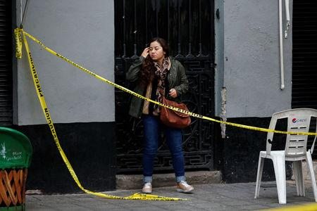 A resident gestures while looking at a crime scene hours after unknown assailants attacked people with rifles and pistols at an intersection on the edge of the tourist Plaza Garibaldi in Mexico City, Mexico September 15, 2018. REUTERS/Gustavo Graf