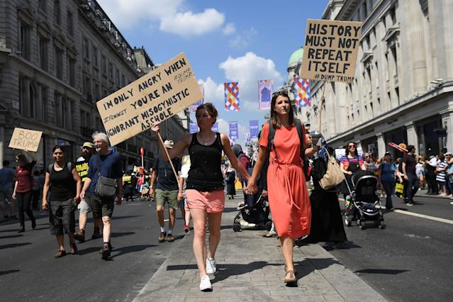 <p>Protesters join a Women's march in central London to demonstrate against President Trump's visit to the UK, on July 13, 2018 in London, England. (Photo: Chris J. Ratcliffe/Getty Images) </p>