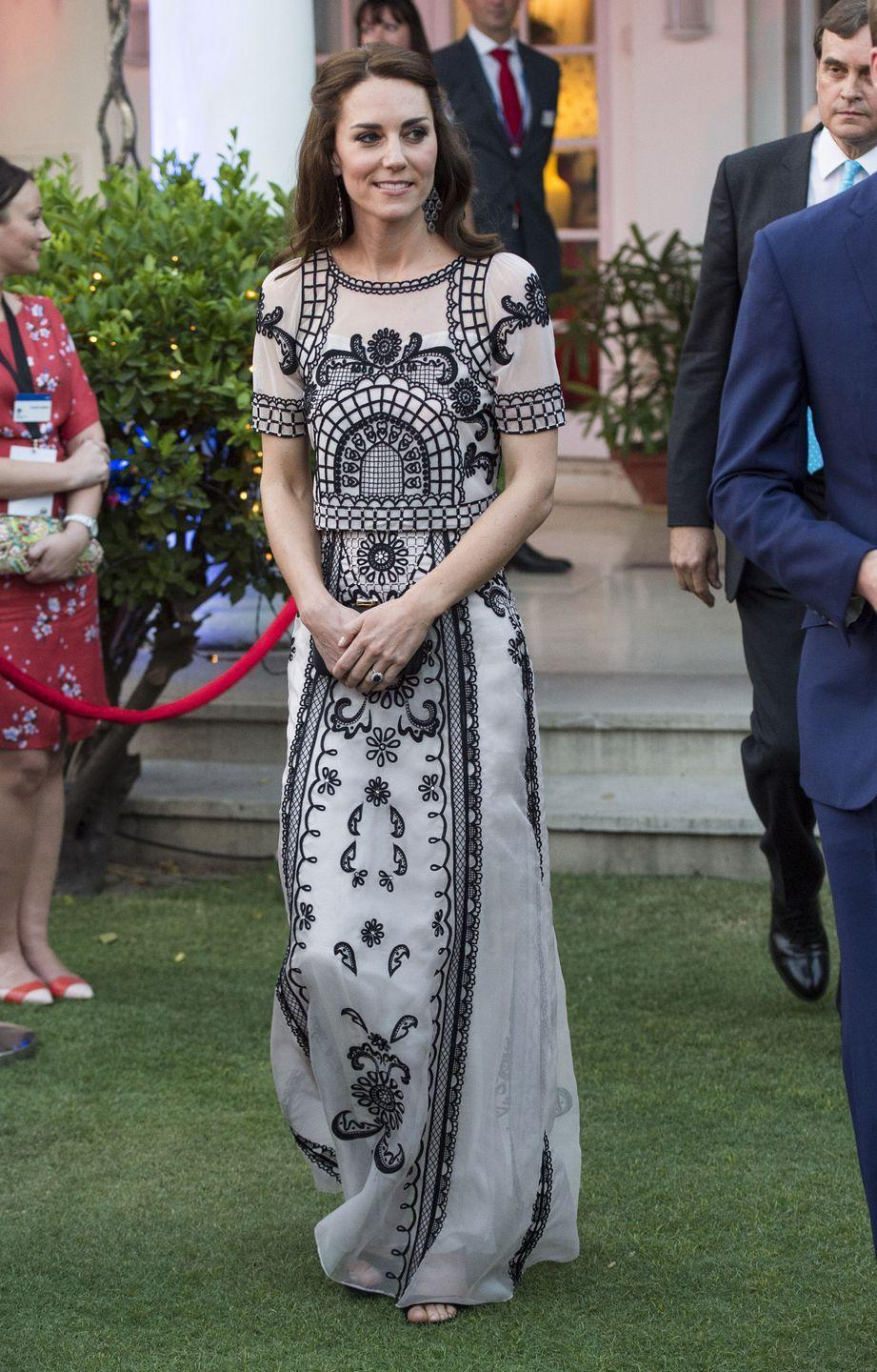 <p>Kate wears a white gown with black embroidery to a garden party celebrating the Queen's 90th birthday in New Dehli. </p>