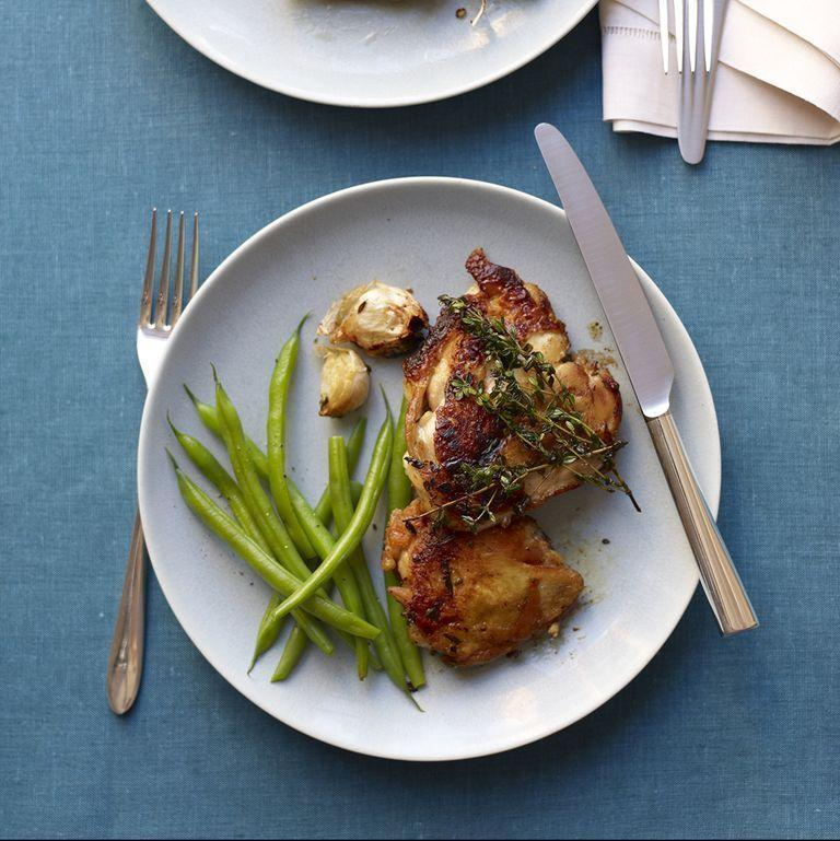"""<p>This classic chicken recipe is easy to make and tastes great. Served with a side of greens or your favorite vegetable, it's a staple that you can come back to again and again. </p><p><em><a href=""""https://www.womansday.com/food-recipes/food-drinks/recipes/a11967/brick-chicken-garlic-thyme-recipe-122887/"""" rel=""""nofollow noopener"""" target=""""_blank"""" data-ylk=""""slk:Get the Brick Chicken with Garlic and Thyme recipe."""" class=""""link rapid-noclick-resp"""">Get the Brick Chicken with Garlic and Thyme recipe. </a></em></p>"""