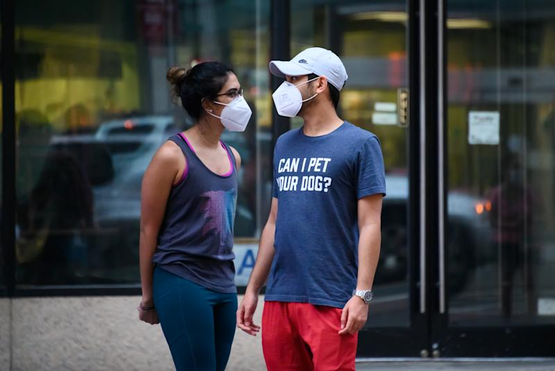 NEW YORK, NEW YORK - MAY 30: People wear protective face masks in Murray Hill during the coronavirus pandemic on May 30, 2020 in New York City. Government guidelines encourage wearing a mask in public with strong social distancing in effect as all 50 US states have begun to slowly reopen after weeks of stay-at-home measures to control the spread of COVID-19. (Photo by Noam Galai/Getty Images)