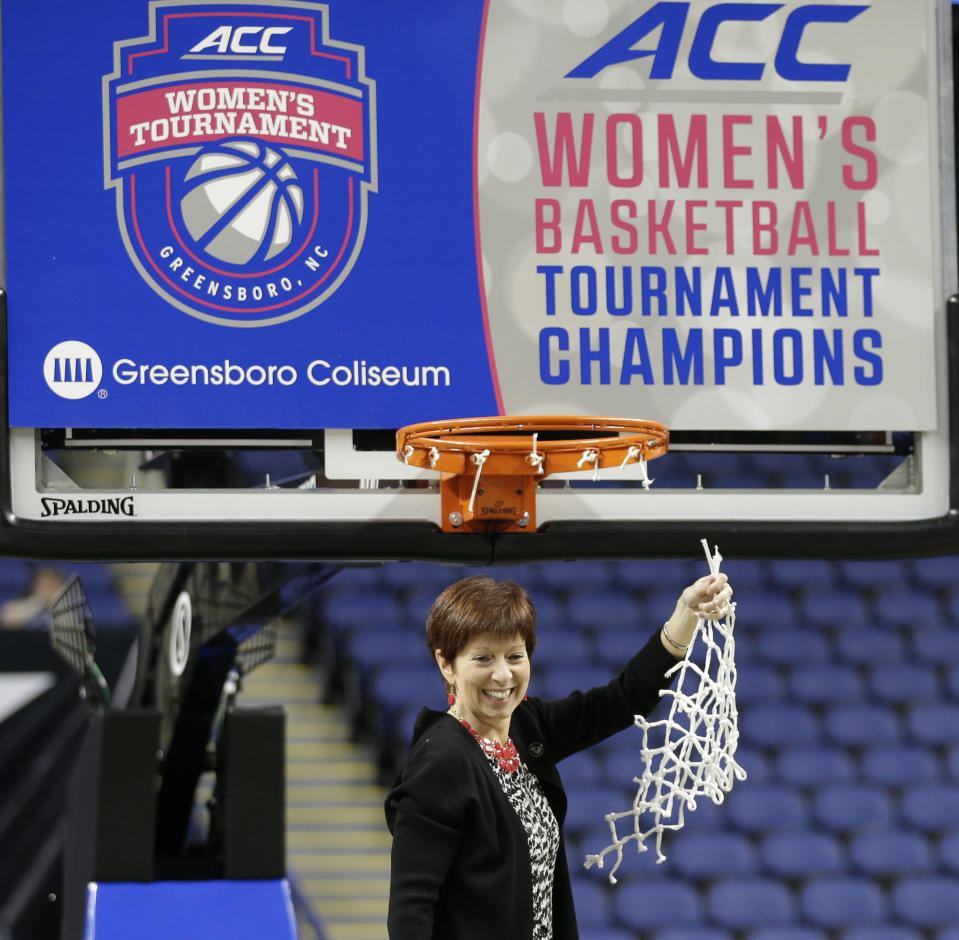 FILE - Notre Dame head coach Muffet McGraw celebrates after an NCAA college basketball game against Florida State in the championship of the Atlantic Coast Conference tournament in Greensboro, N.C., in this Sunday, March 8, 2015, file photo. Muffet McGraw has kept busy since retiring last spring from coaching Notre Dame. From teaching a sports business leadership class at the university to helping on Election Day as a poll worker, the Hall of Famer women's basketball coach has stayed active. Now she's ready to add a new job to her list, serving as a studio analyst for the ACC Network.(AP Photo/Chuck Burton, File)