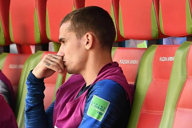 Benched: Antoine Griezmann was replaced by Olivier Giroud with 20 minutes remaining against Australia (AFP Photo/FRANCK FIFE)
