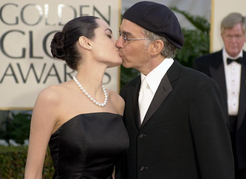 FILE - In this Jan. 20, 2002 file photo, Billy Bob Thornton kisses his wife, Angelina Jolie after arriving for the 59th Annual Golden Globe Awards in Beverly Hills, Calif. Angelina Jolie Pitt has filed for divorce from Brad Pitt, bringing an end to one of the world's most star-studded, tabloid-generating romances. This is the third for Jolie Pitt, who was previously married to Billy Bob Thornton and Jonny Lee Miller. (AP Photo/Kevork Djansezian, File)
