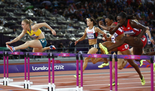 Australia's Sally Pearson (front) clears a hurdle to win gold in the women's 100m hurdles final during the London 2012 Olympic Games at the Olympic Stadium August 7, 2012. REUTERS/Kai Pfaffenbach (BRITAIN - Tags: OLYMPICS SPORT ATHLETICS)