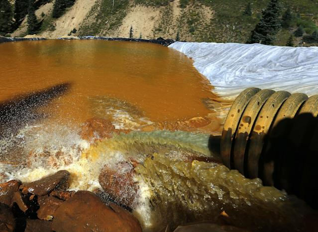 "<span class=""s1"">Water flows through sediment retention ponds built to reduce contaminants from Colorado's massive Gold King Mine accident in 2015. (Photo: Brennan Linsley/AP)</span>"