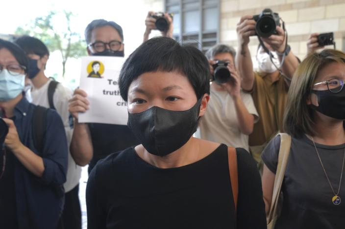 Hong Kong journalist Choy Yuk-ling, also known as Bao Choy, arrives a court in Hong Kong Thursday, April 22, 2021. Hong Kong journalist Choy appeared in court on Thursday for verdict on charges of making false statements while obtaining information from a vehicle database. Choy, a producer at public broadcaster Radio Television Hong Kong, was arrested in Nov. 2020. She was involved in the production of an investigative documentary into the behavior of Hong Kong police during 2019 anti-government protests, after the force was accused of not intervening during a violent clash between protesters and a mob of men in a subway station. (AP Photo/Kin Cheung)