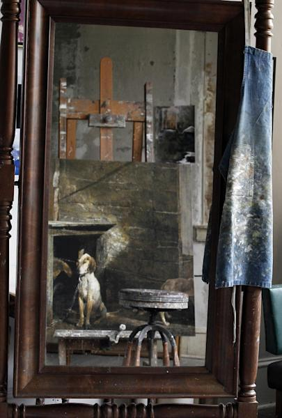 An apron and painting are reflected in a mirror during a preview tour of the home and studio of artist Andrew Wyeth Monday, April 23, 2012 in Chadd's Ford, Pa. The studio will be open for tours in the summer of 2012 by the Brandywine River Museum. (AP Photo/Alex Brandon)