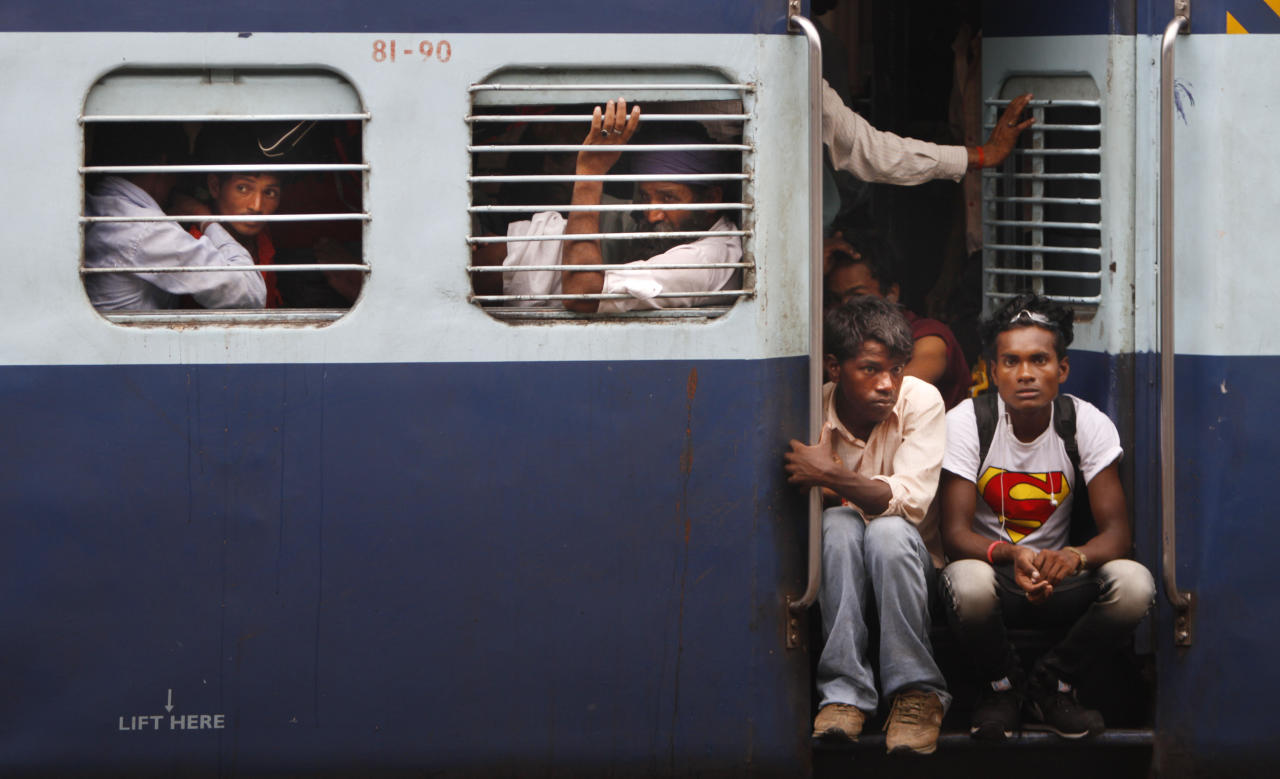 Passengers sit in a train and wait for power to be restored at a railway station, in New Delhi, India, Monday, July 30, 2012. The electricity grid across northern India failed Monday, leaving hundreds of millions of people without electricity in one of the worst power failures of the past decade, officials said. (AP Photo/Rajesh Kumar Singh)