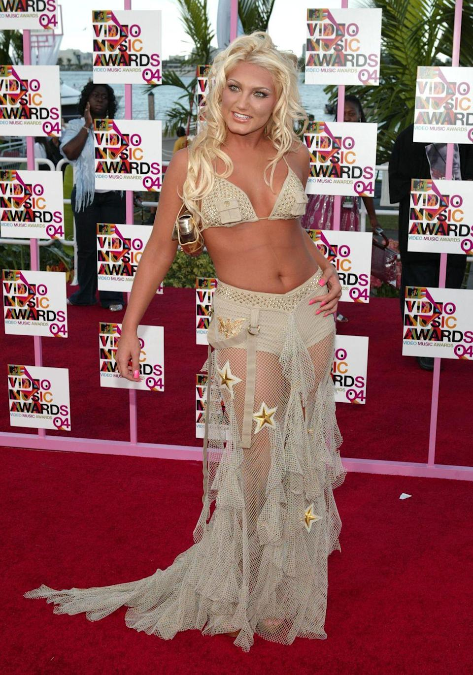 <p>The <em>Hogan Knows Best</em> star, Brooke Hogan, poses at the 2004 MTV Video Music Awards in beige on beige greatness. The entire Hogan family starred in VH1's <em>Hogan Knows Best</em> for four seasons before Brooke landed her own spin-off <em>Brooke Knows Best, </em>which lasted for two.</p>