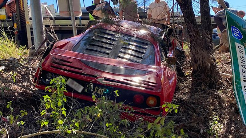 Pictured the back of the Ferrari hanging in the ditch. Source: Facebook