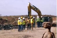 """An E.T. doll is seen while construction workers prepare to dig into a landfill in Alamogordo, N.M., Saturday, April 26, 2014. Producers of a documentary are digging in the landfill in search of millions of cartridges of the Atari 'E.T. the Extra-Terrestrial' game that has been called the worst game in the history of videogaming. A New York Times article from 1983 reported that Atari cartridges of """"E.T. The Extraterrestrial"""" were dumped in the landfill in Alamogordo. (AP Photo/Juan Carlos Llorca)"""