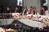 Armenian Apostolic Church leader Catholicos Garegin II, center, attends a memorial service at the monument to the victims of mass killings by Ottoman Turks, to commemorate the 106th anniversary of the massacre, in Yerevan, Armenia, Saturday, April 24, 2021. Armenians marked the anniversary of the death of up to 1.5 million Armenians by Ottoman Turks, an event widely viewed by scholars as genocide, though Turkey refutes the claim. (Grigor Yepremyan/PAN Photo via AP)