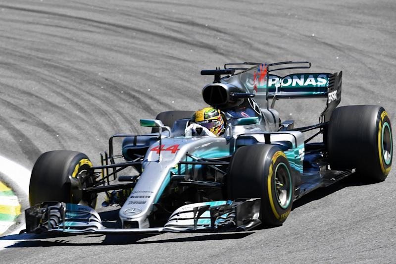 World beater: Lewis secured his fourth title at a canter this year although he was helped by Ferrari's mistakes: AFP/Getty Images