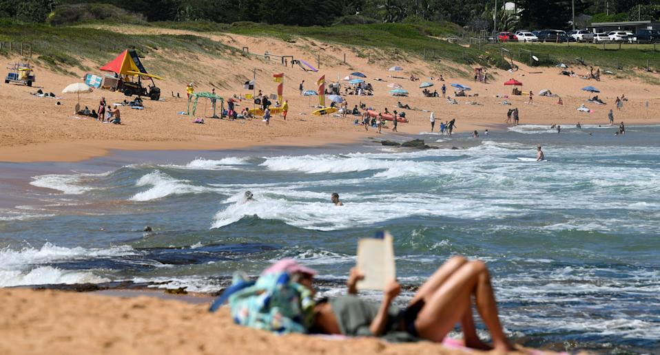 People relax on NSW beach.
