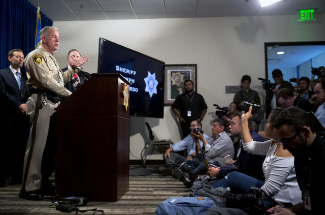 Clark County Sheriff Joe Lombardo, center, responds to a question during a media briefing at the Las Vegas Metro Police headquarters in Las Vegas, Tuesday, Oct. 3, 2017. (Steve Marcus/Las Vegas Sun via AP)